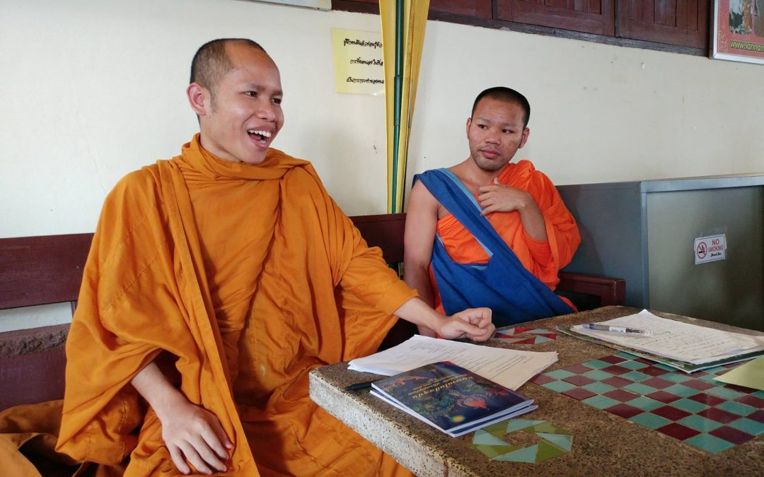 Buddhist monks wearing orange robes