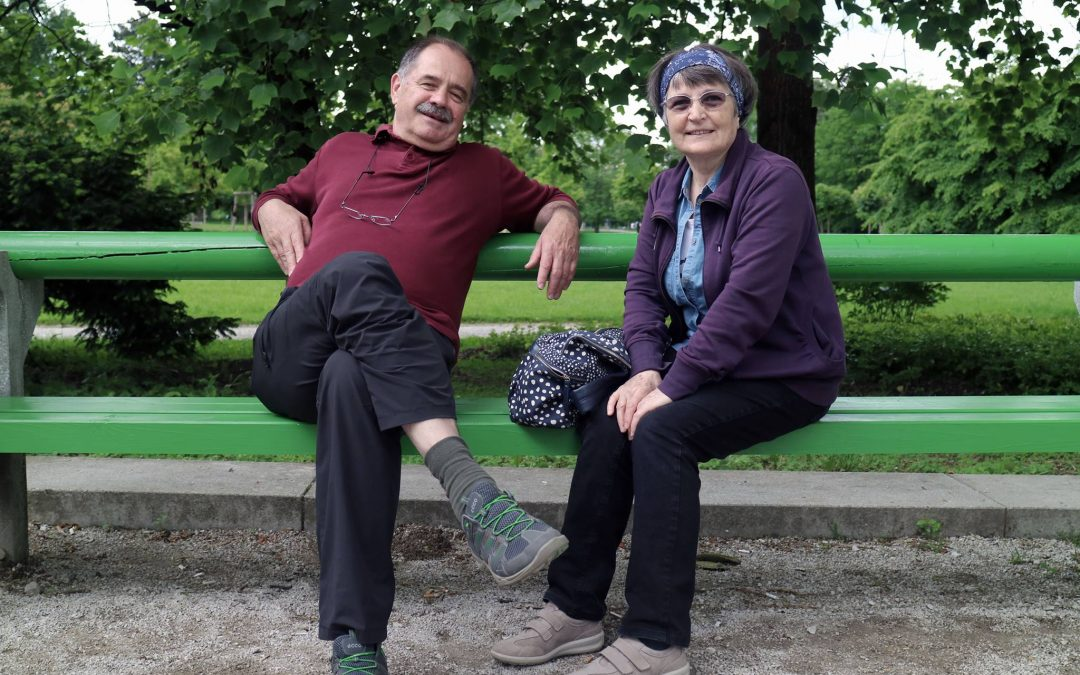 Elder couple relaxing on a bench together