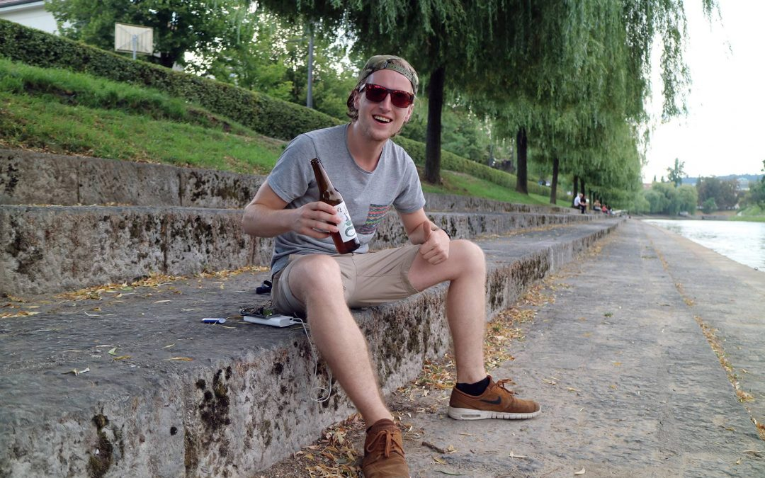 Young male human very happy drinking beer