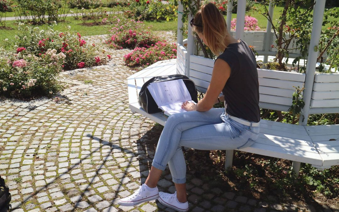 Young female human studying outside