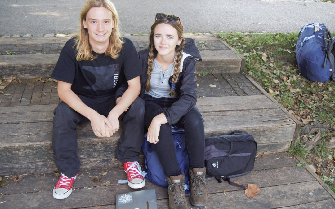 Young travelling couple hanging out