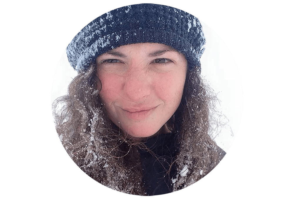 Human female scrunching up her nose in the snow