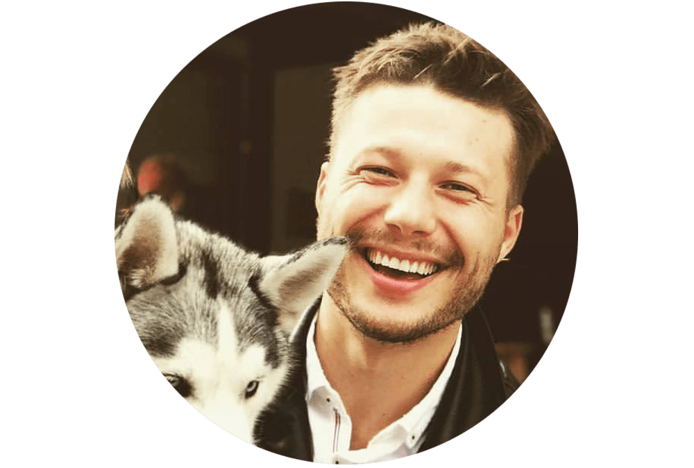 Male human smiling with a dog